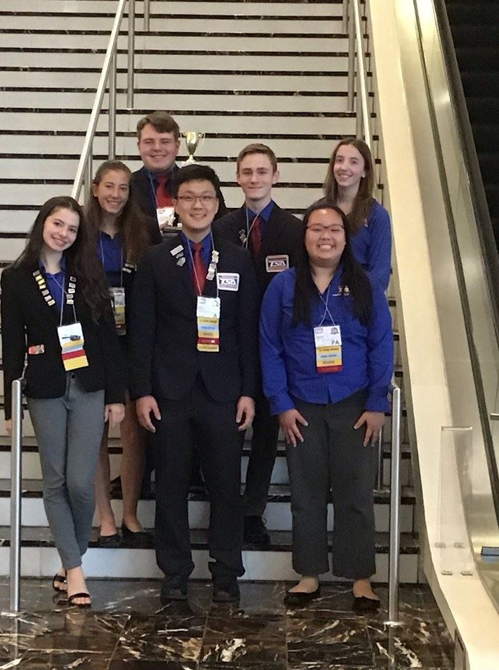 High School TSA students stand with their award